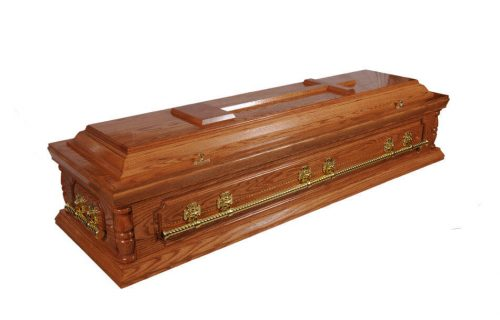 A solid American oak casket in a medium shade with full length panel and high gloss finish. Fitted with solid full length twist metal bar handles and high quality white interior.